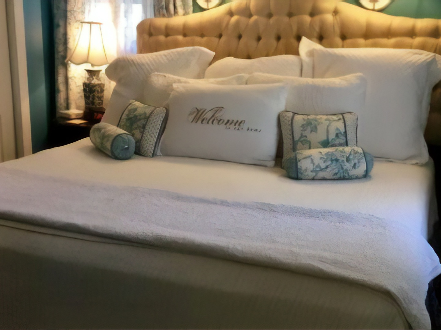 A large white bed sitting in a room at Abbington Green Bed & Breakfast Inn.
