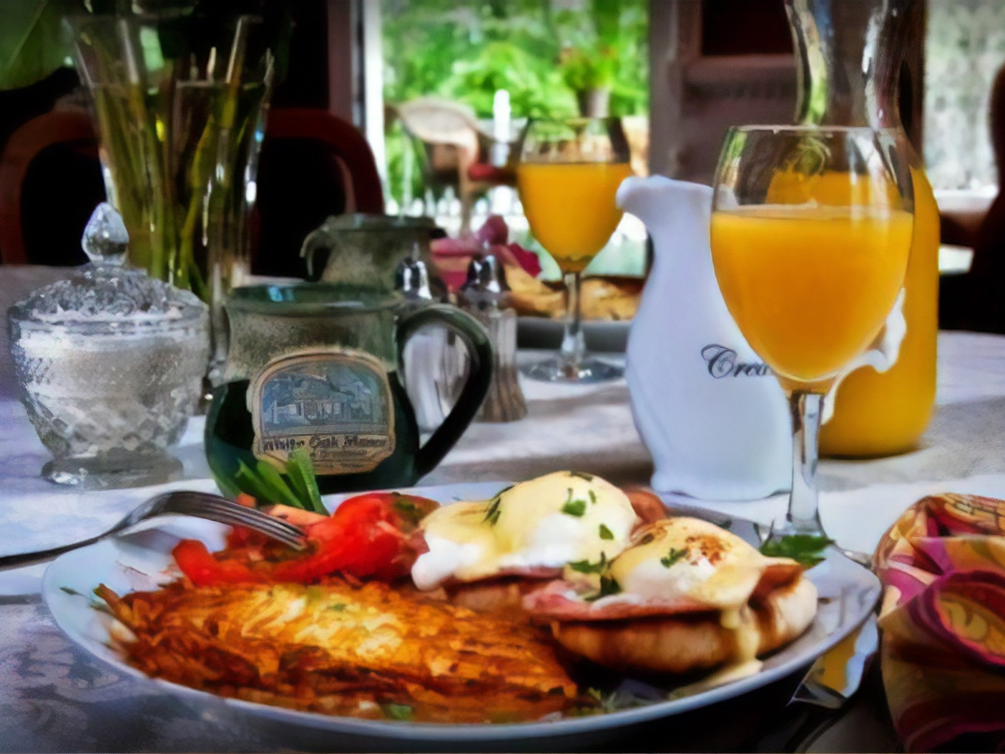 A plate of food and a glass of wine at White Oak Manor Bed and Breakfast.