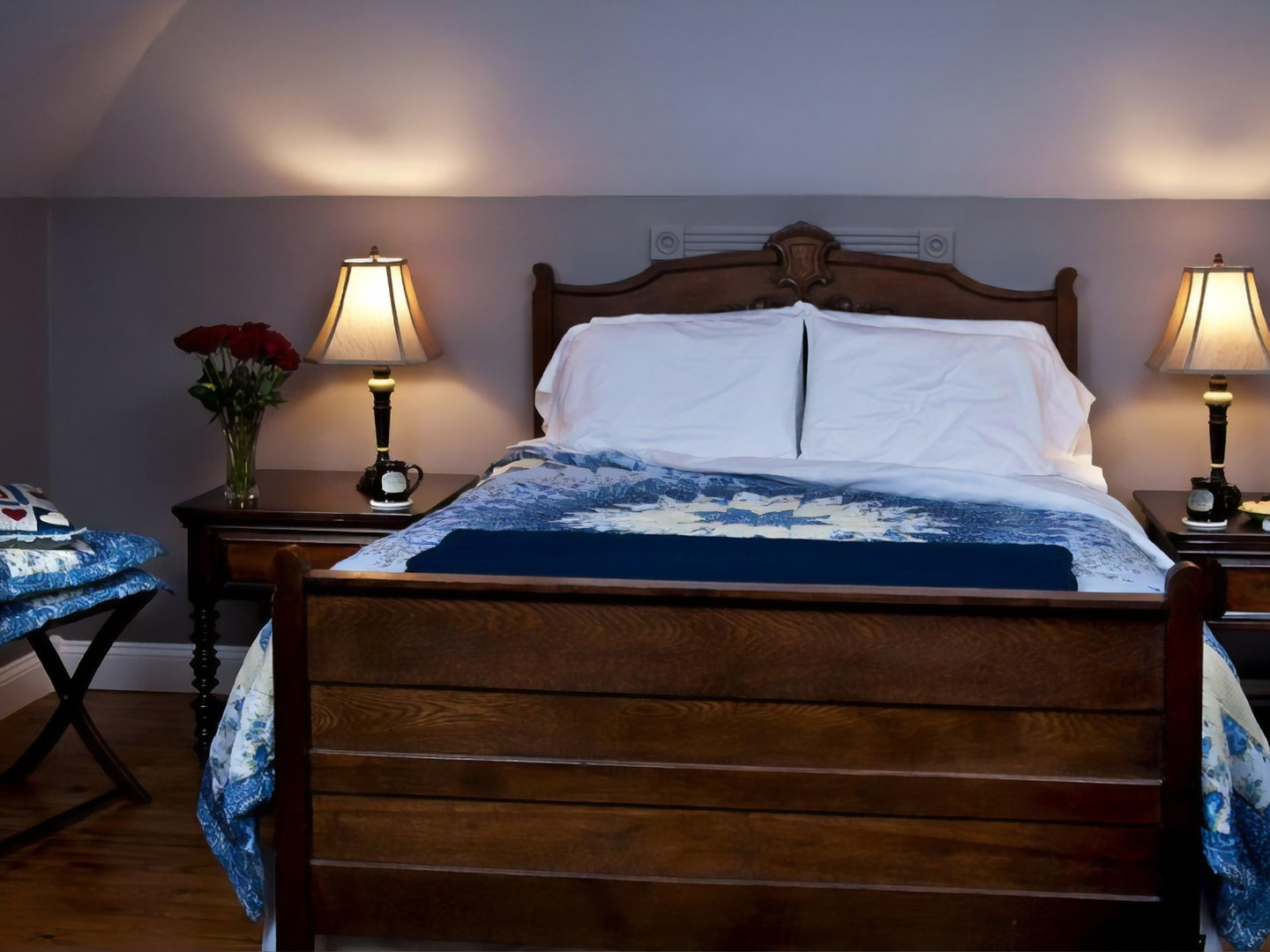 A bedroom with a bed and desk in a room at White Oak Manor Bed and Breakfast.