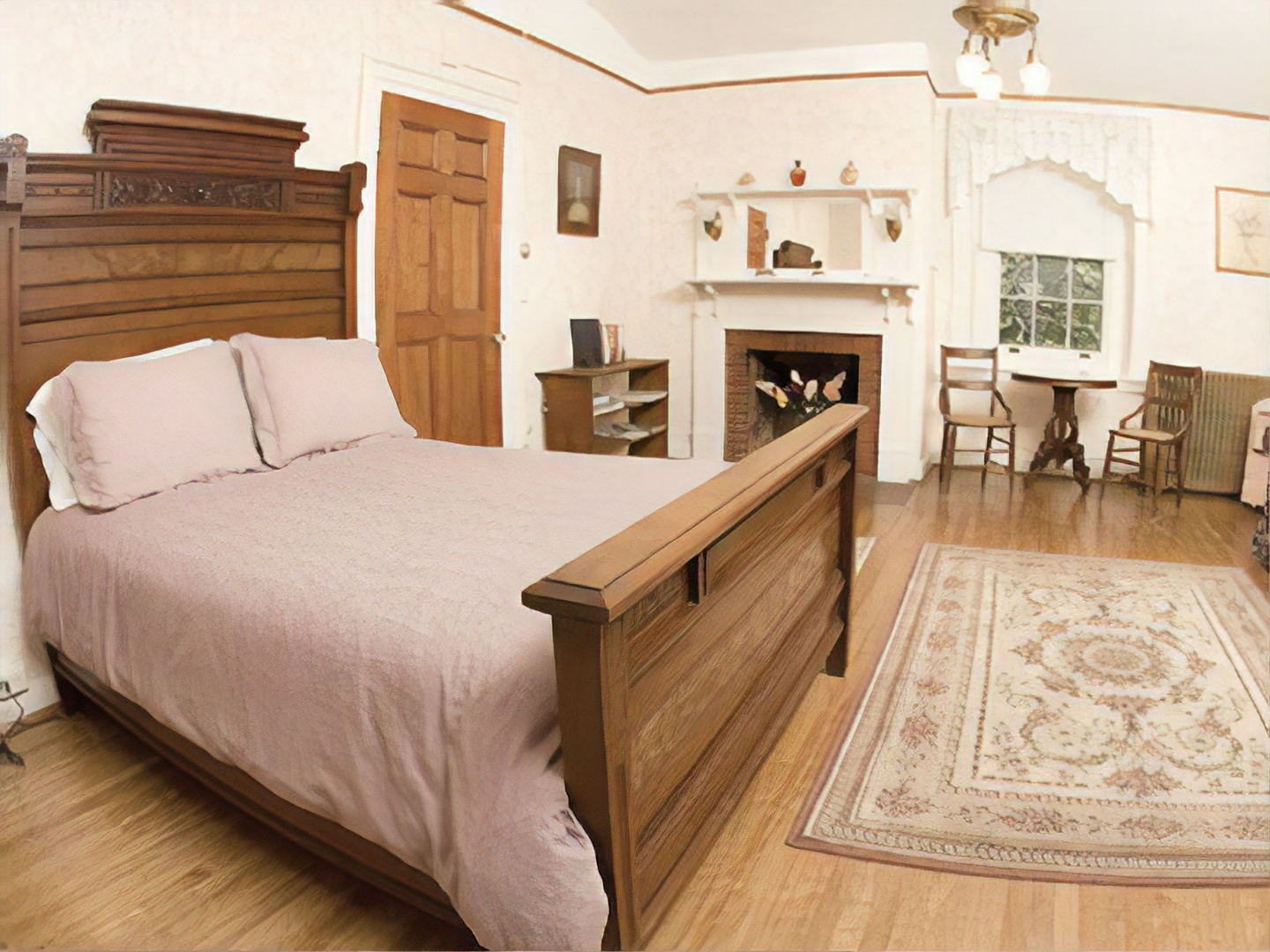 A bedroom with a bed and desk in a room at Catamount Bed & Breakfast.