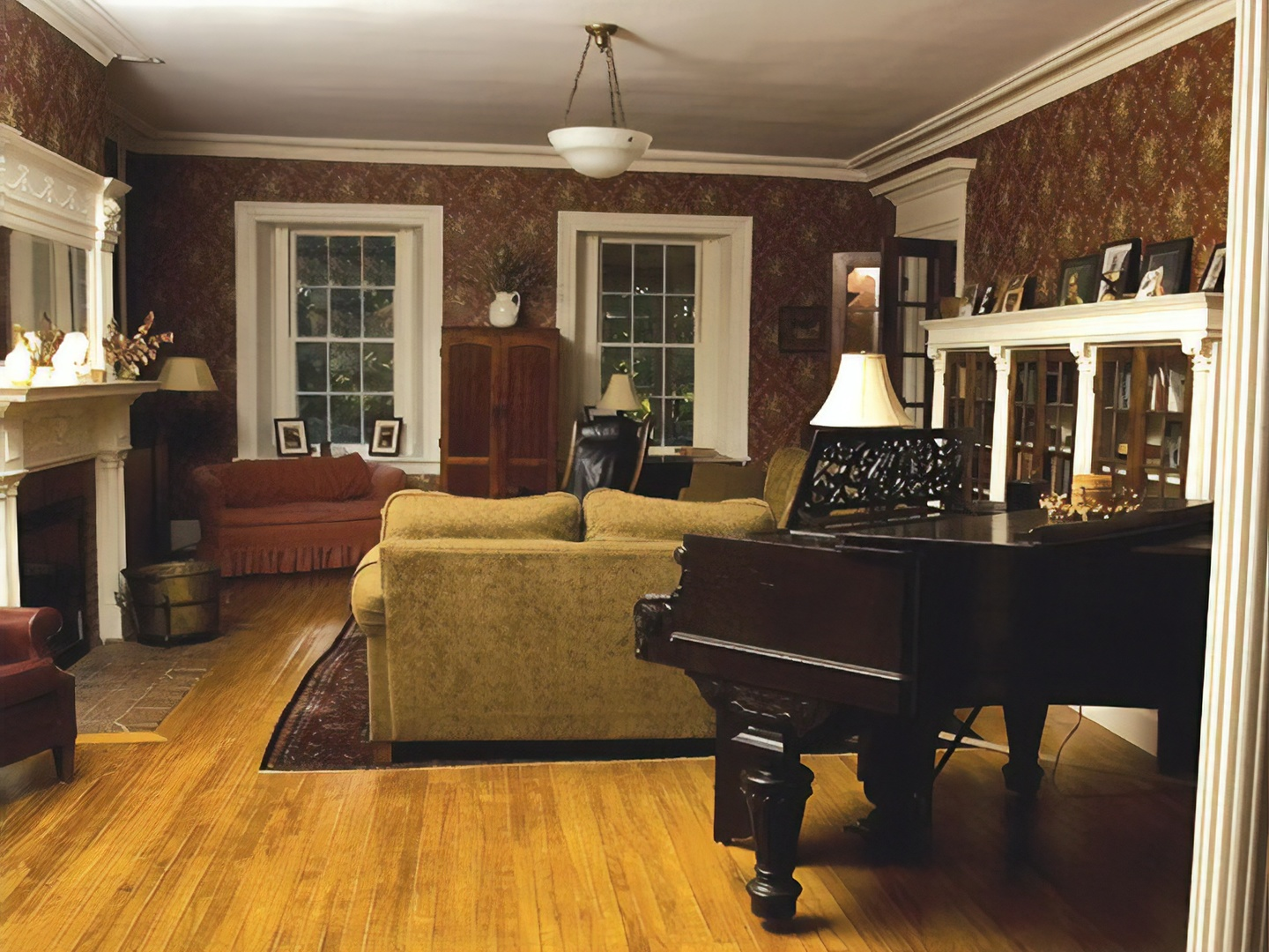 A living room filled with furniture and a large window at Catamount Bed & Breakfast.