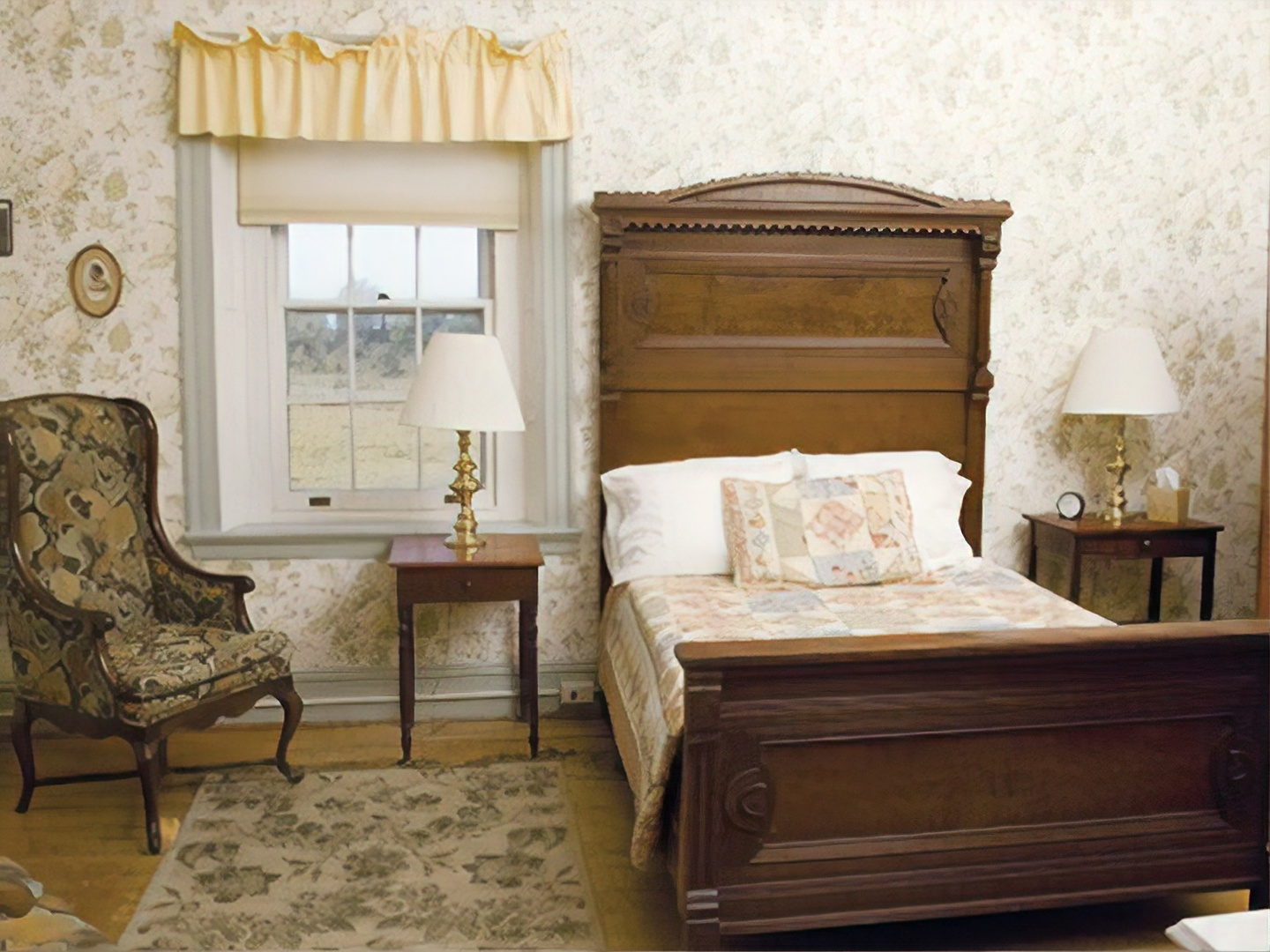 A living room filled with furniture and a fireplace at Catamount Bed & Breakfast.