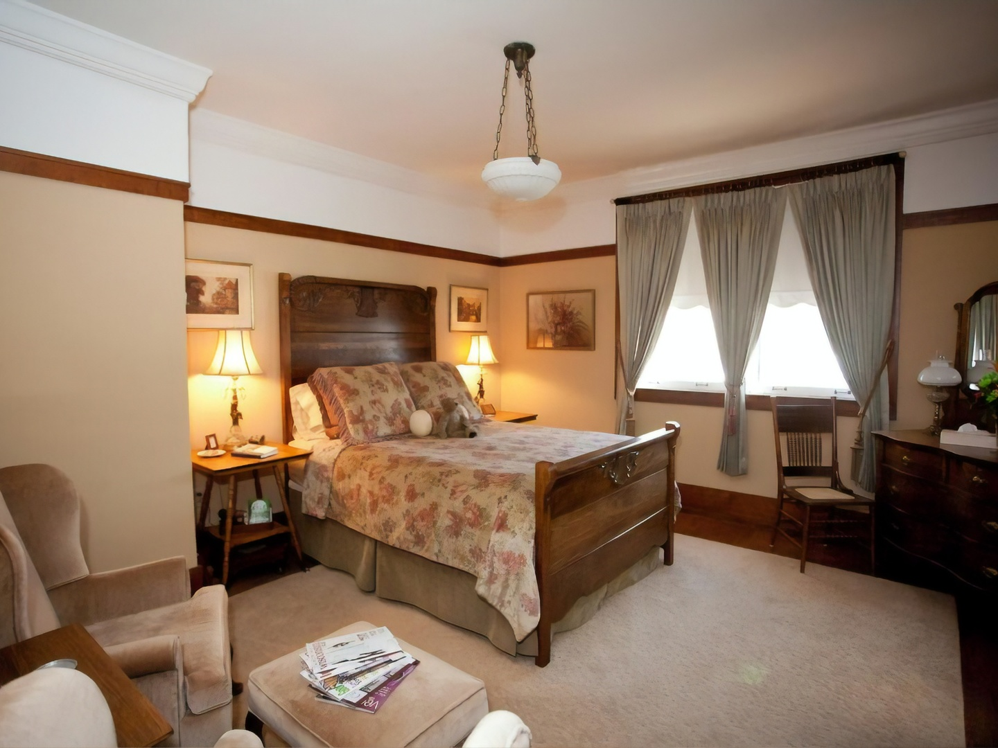 A living room filled with furniture and a bed in a bedroom at Westphal Mansion Inn Bed and Breakfast.
