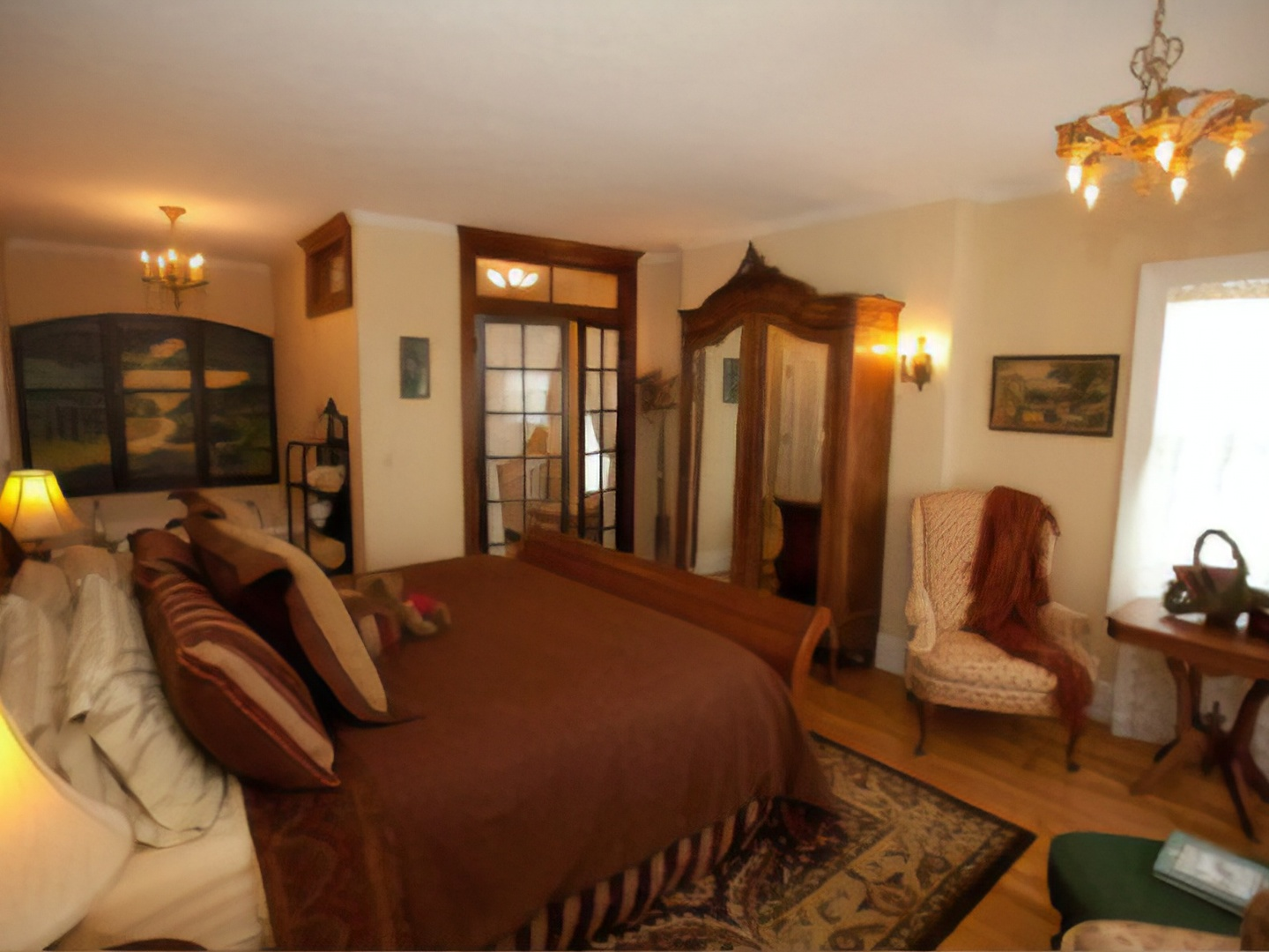 A bedroom with a view of a living room at Westphal Mansion Inn Bed and Breakfast.
