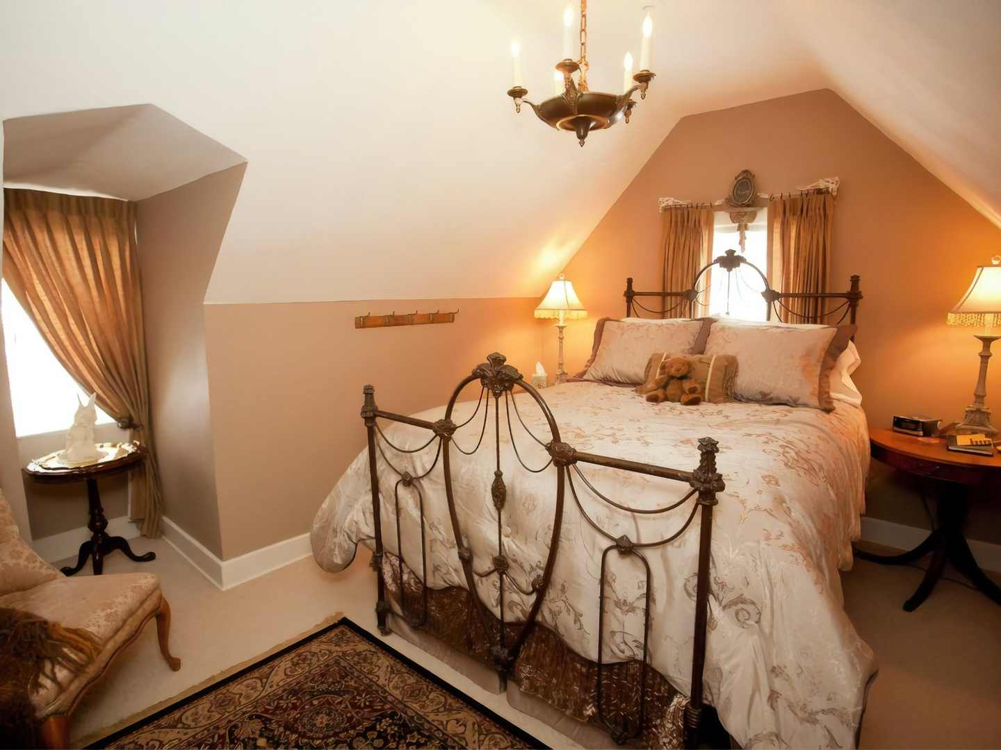 A bedroom with a bed and a mirror in a room at Westphal Mansion Inn Bed and Breakfast.