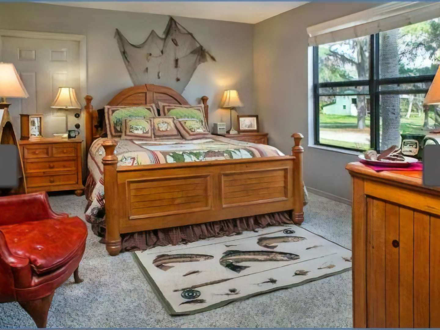 A room filled with furniture and a large window at Hampton Lake Bed & Breakfast.
