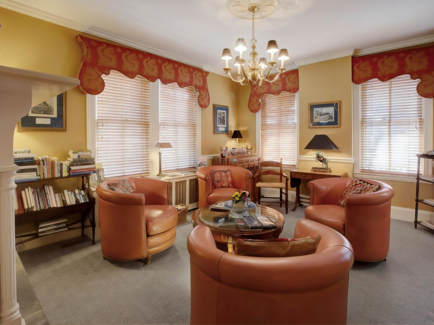 A living room filled with furniture and a large window at Flag House Inn.