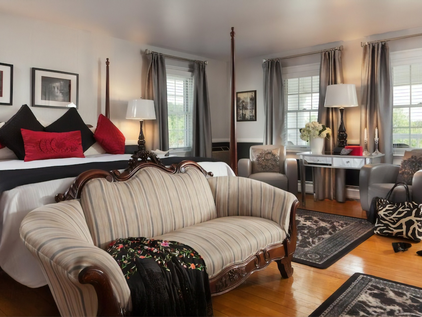 A living room filled with furniture and a large window at Rabbit Hill Inn.