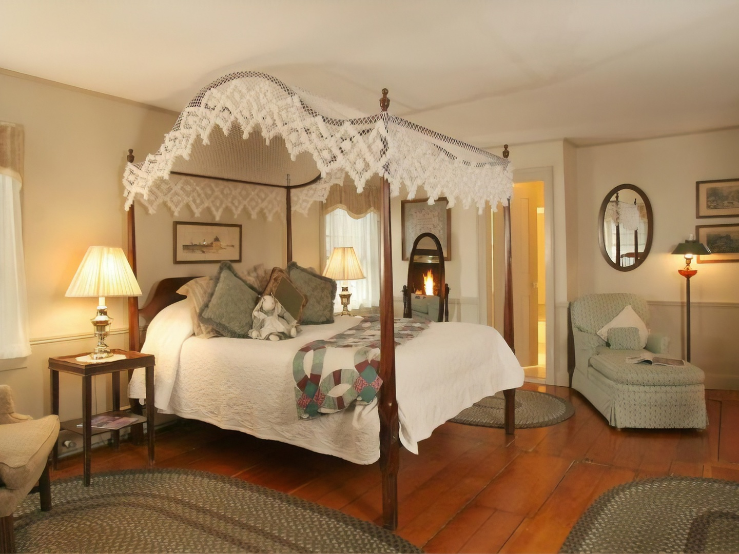 A bedroom with a bed and a chair in a room at Rabbit Hill Inn.