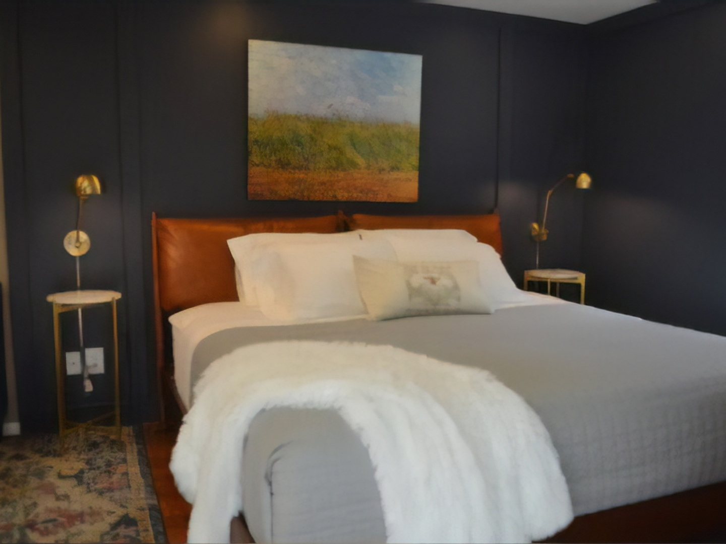 A large white bed in a room at Inn at Blackberry Creek.