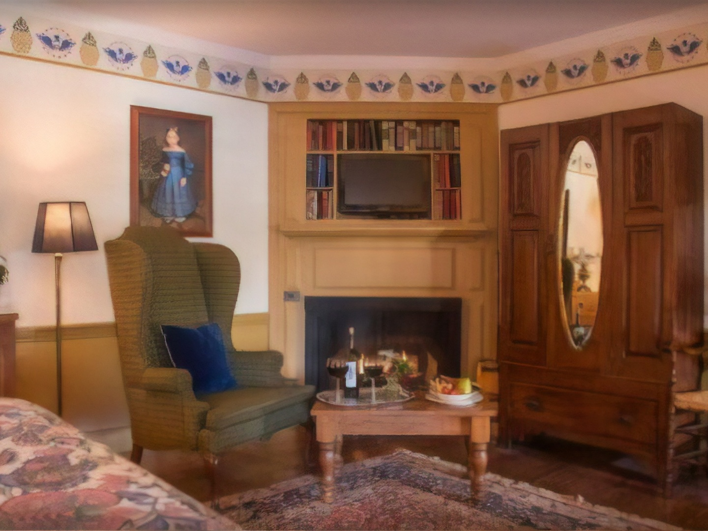 A living room filled with furniture and a fireplace at Asa Ransom House.