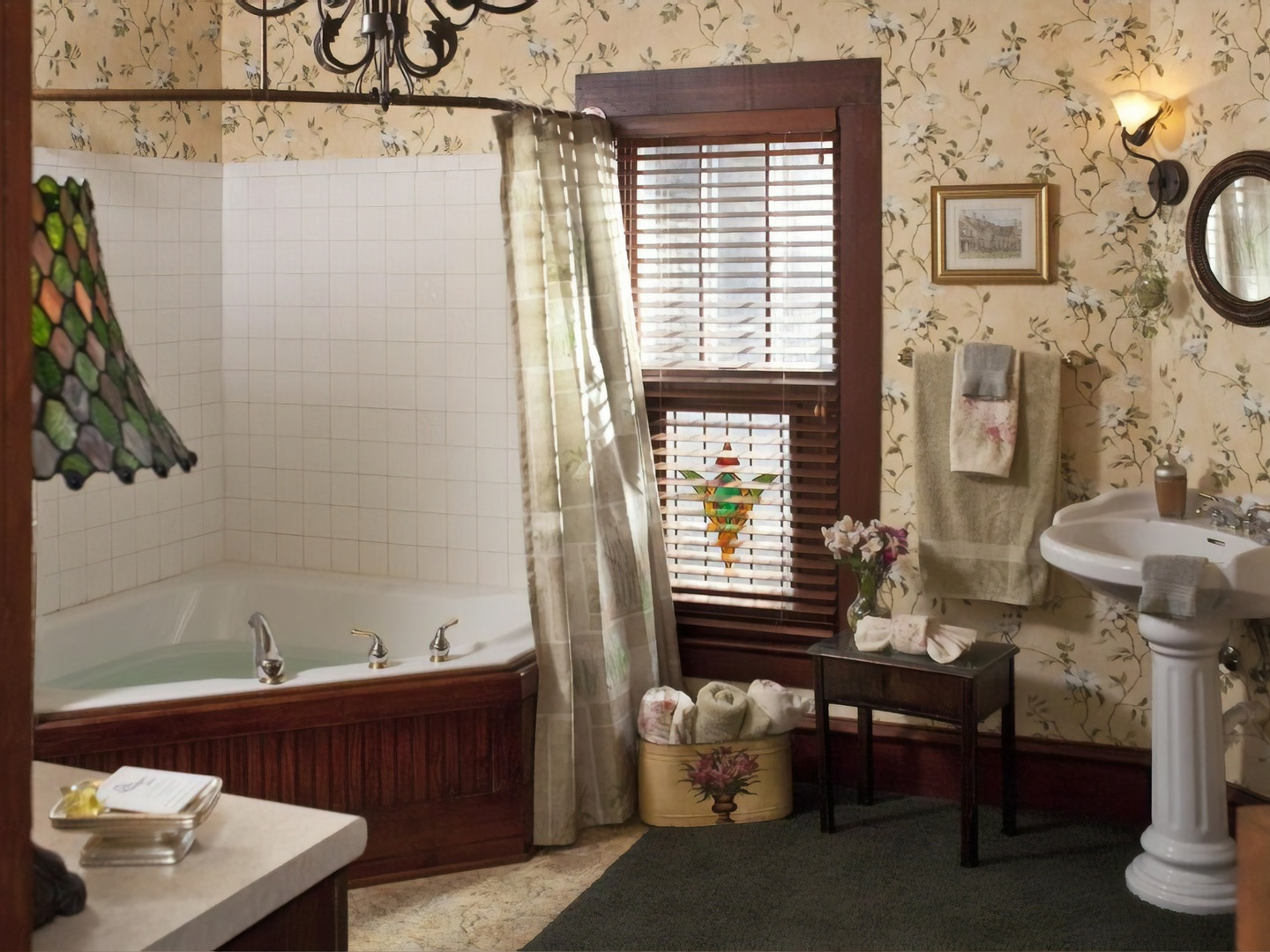 A room with a sink and a window at Cliff Cottage Inn - Boutique Hotel and Bed & Breakfast.