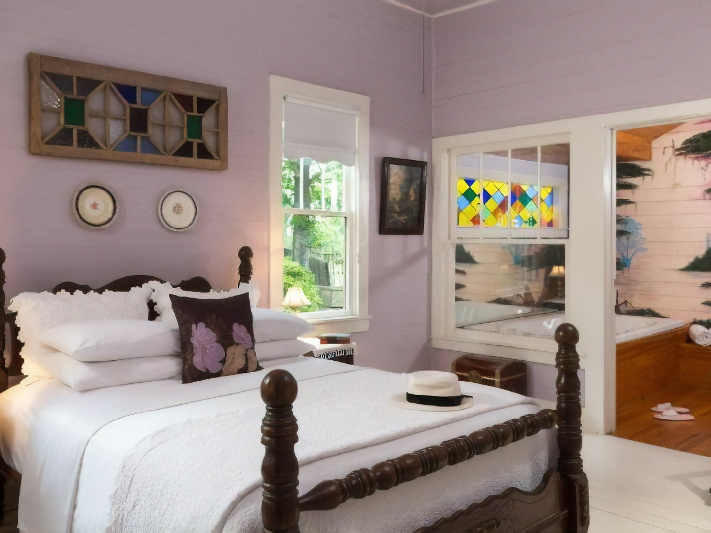 A bedroom with a large bed in a room at Maison D'Memoire B&B Cottages.