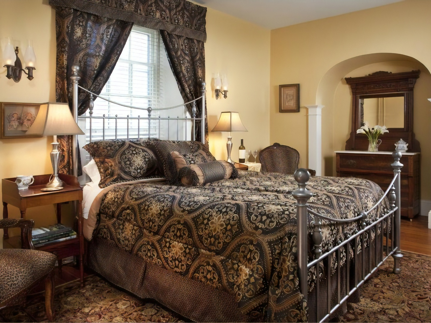 A bedroom with a bed and a chair in a room at Hamanassett Bed & Breakfast.