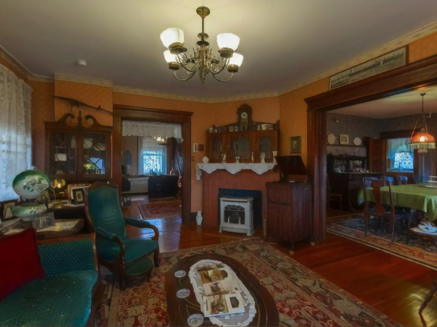 A view of a living room filled with furniture and a fireplace at Candlelight Inn Bed & Breakfast.