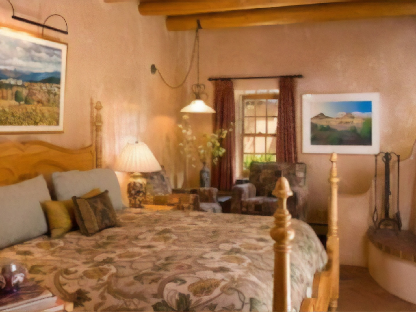 A living room filled with furniture and a fireplace at El Farolito Bed & Breakfast.