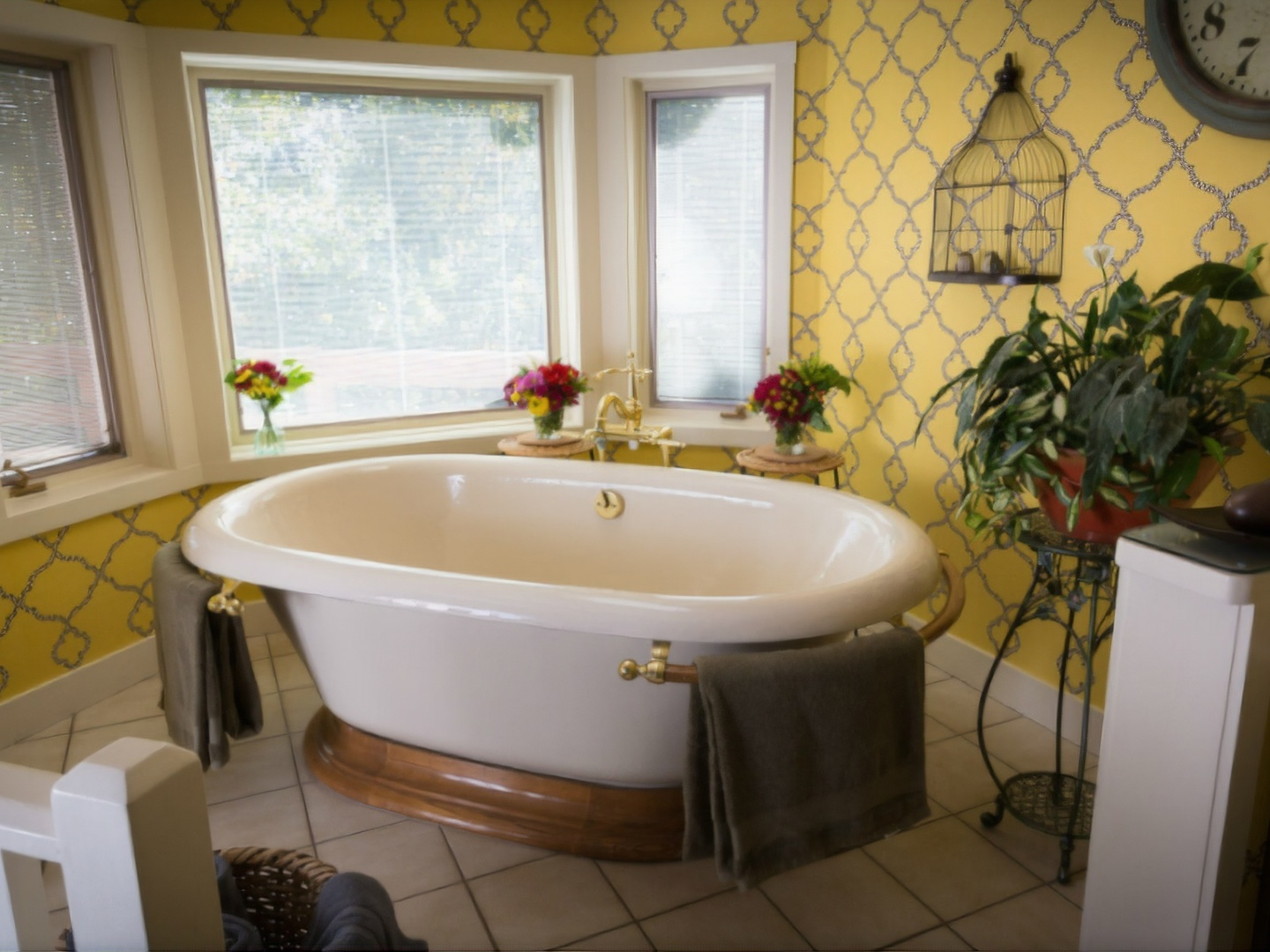 A large white tub sitting next to a window at Country Willows Inn & Estate.