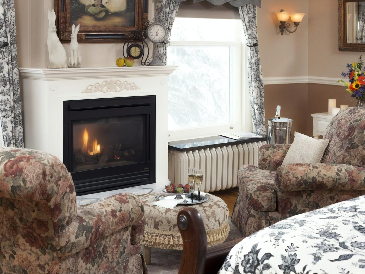 A fire place sitting in a living room with a fireplace at A G Thomson House Bed and Breakfast.