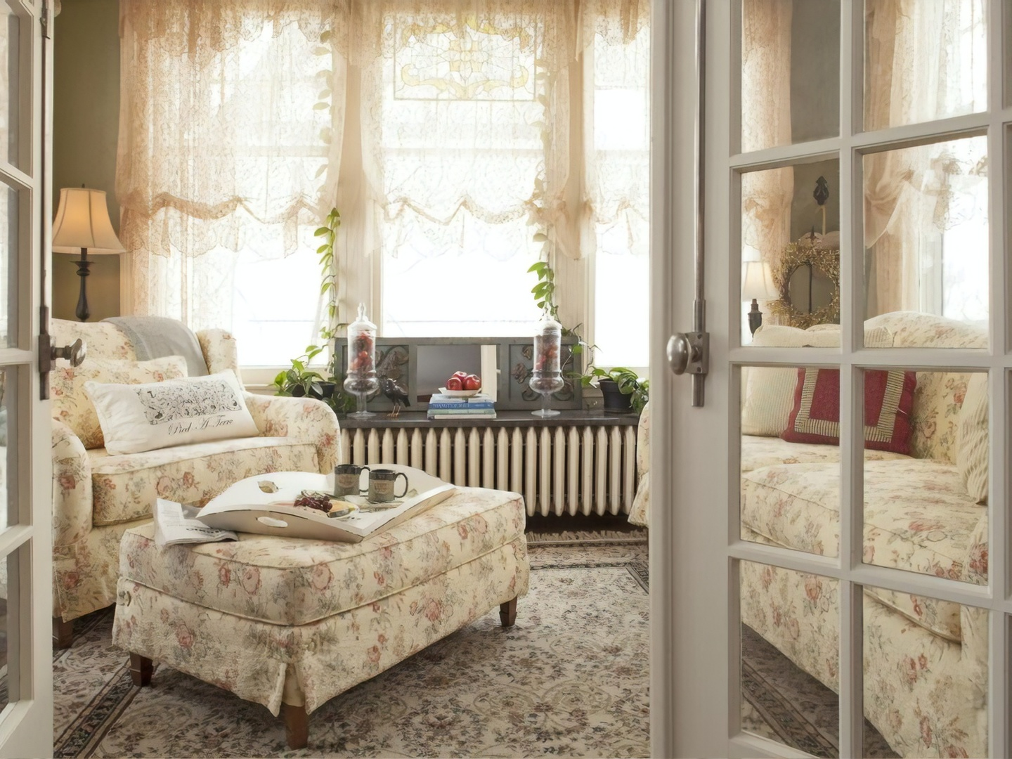 A room filled with furniture and a large window at A G Thomson House Bed and Breakfast.