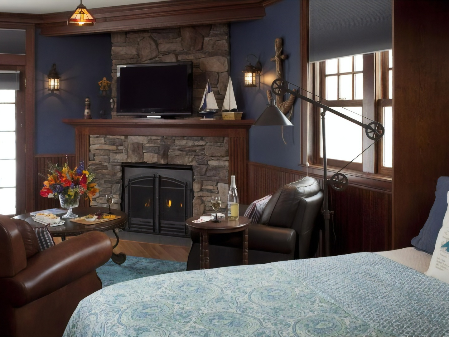 A living room filled with furniture and a large window at A G Thomson House Bed and Breakfast.