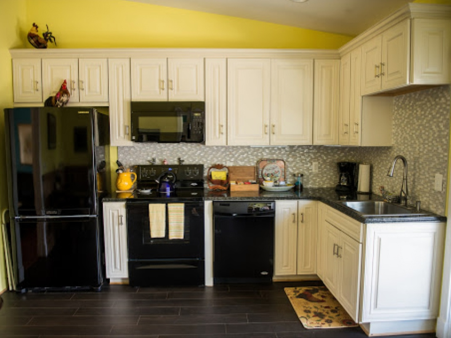 A kitchen with stainless steel appliances and wooden cabinets at Briar Patch Bed & Breakfast Inn.