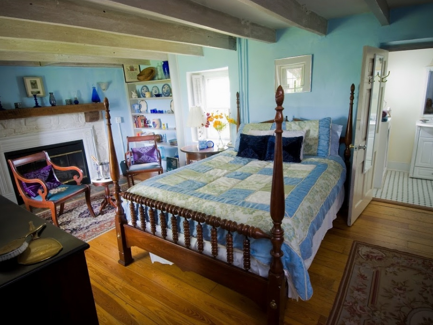 A bedroom with a bed and desk in a room at Briar Patch Bed & Breakfast Inn.