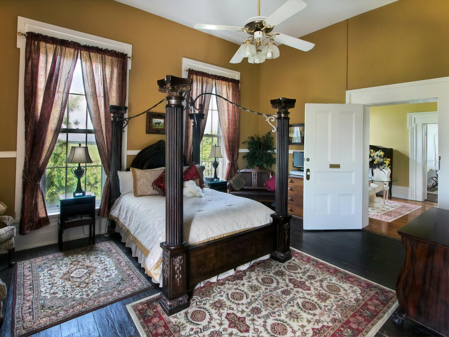 A bedroom with a large bed in a room at Historic Maple Hill Manor B&B.