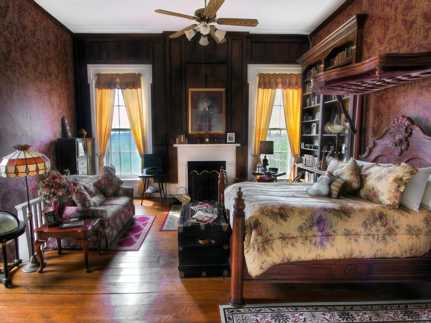 A living room filled with furniture and a fire place at Historic Maple Hill Manor B&B.