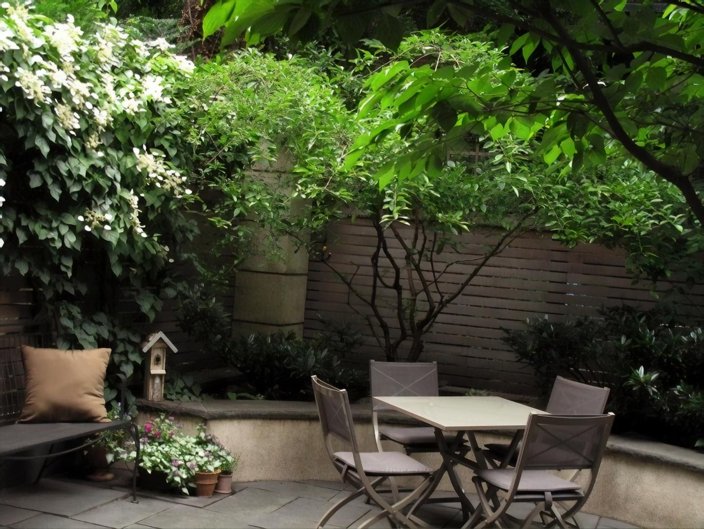 A bench in a garden at A Garden In Chelsea.