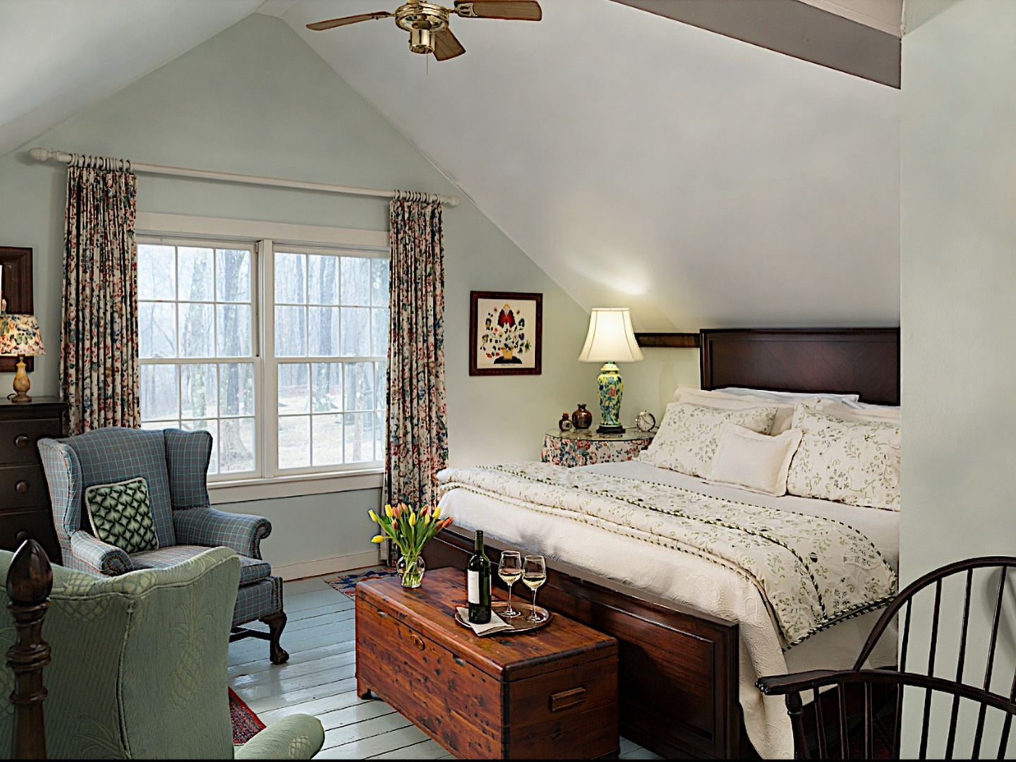 A bedroom with a bed and furniture in a room at The Inn at Green River.