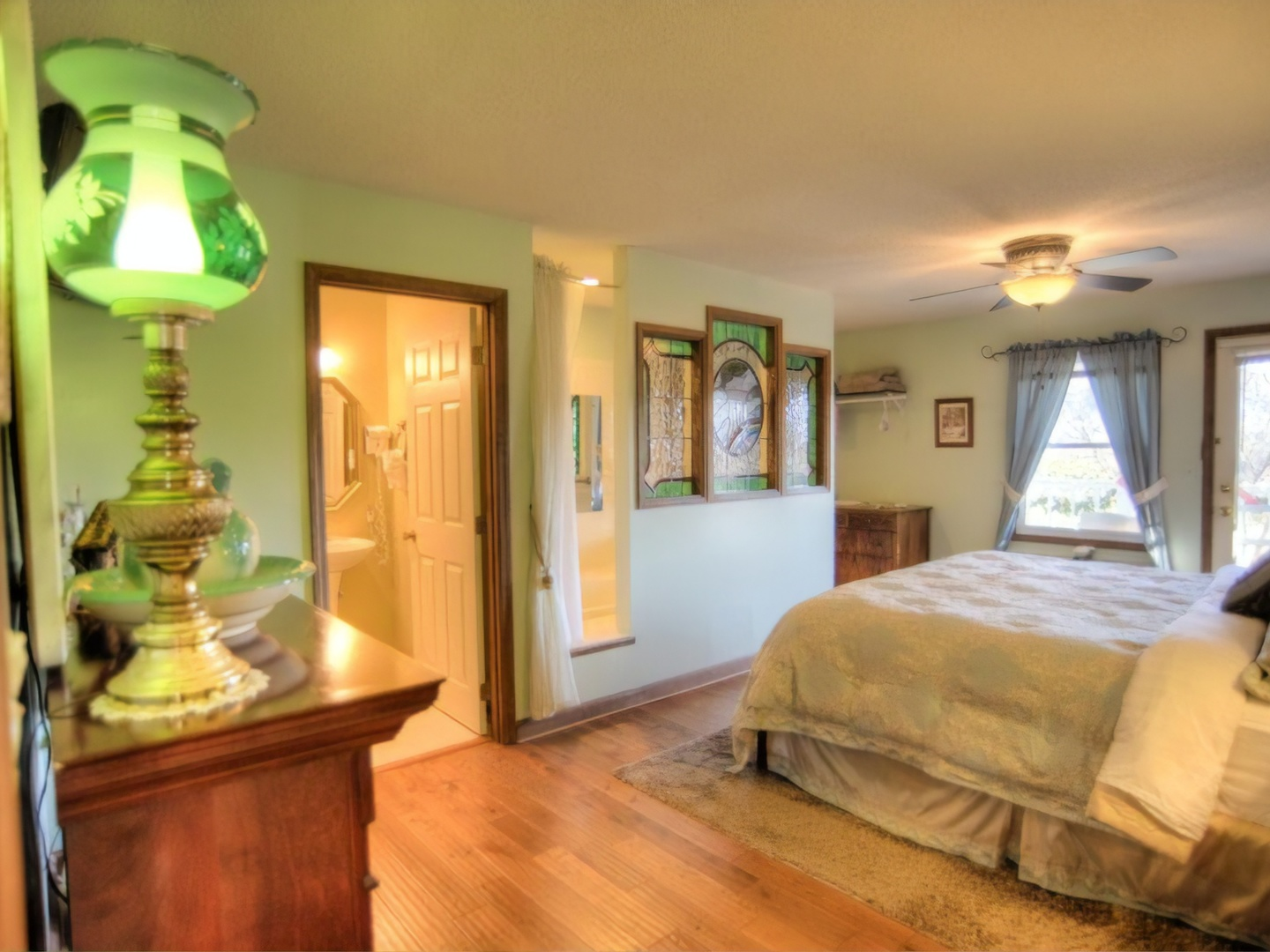 A bedroom with a bed and a mirror at Blue Mountain Mist Country Inn and Cottages.