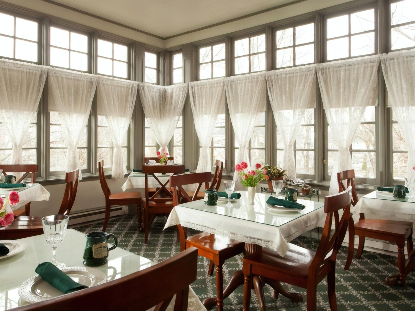 A dining room table in front of a window at Lafayette Inn.