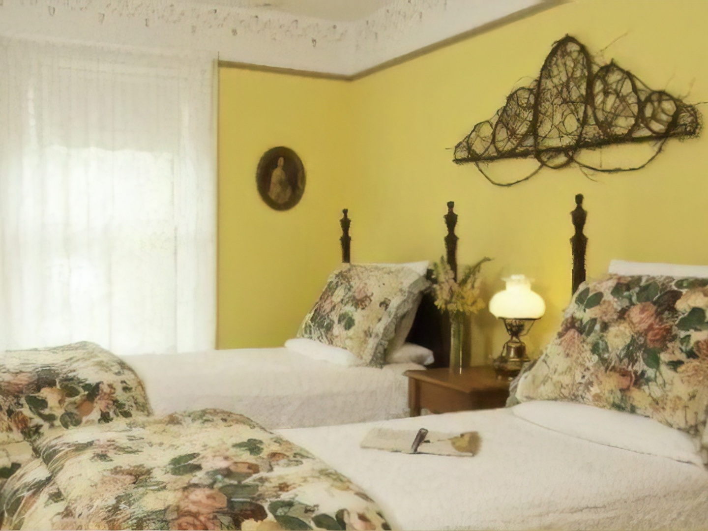 A bedroom with a bed in a hotel room at Golden Stage Inn Bed and Breakfast.