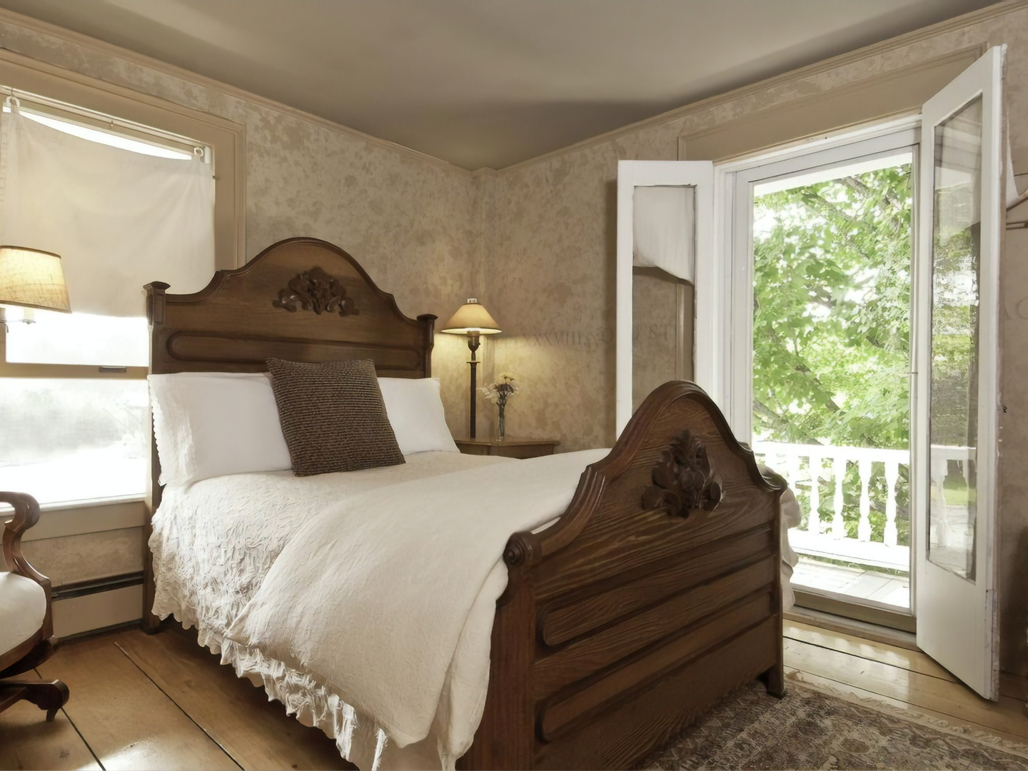 A bedroom with a bed and a window at Golden Stage Inn Bed and Breakfast.