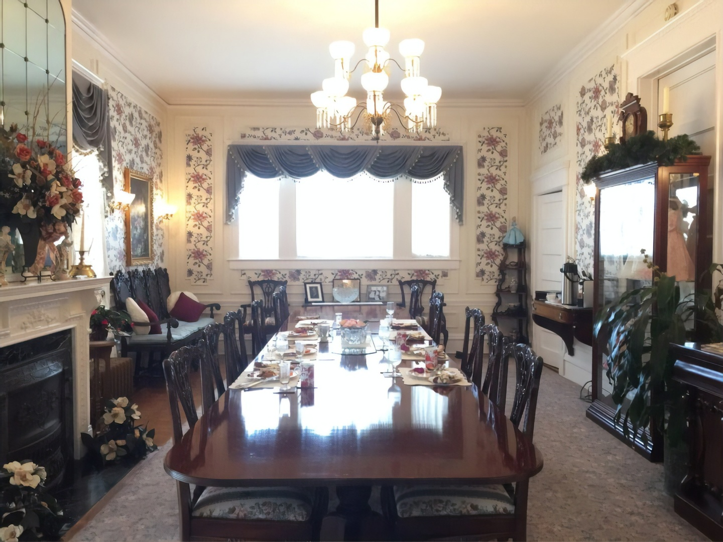A view of a living room filled with furniture and a fire place at Rosehill Inn Bed & Breakfast.