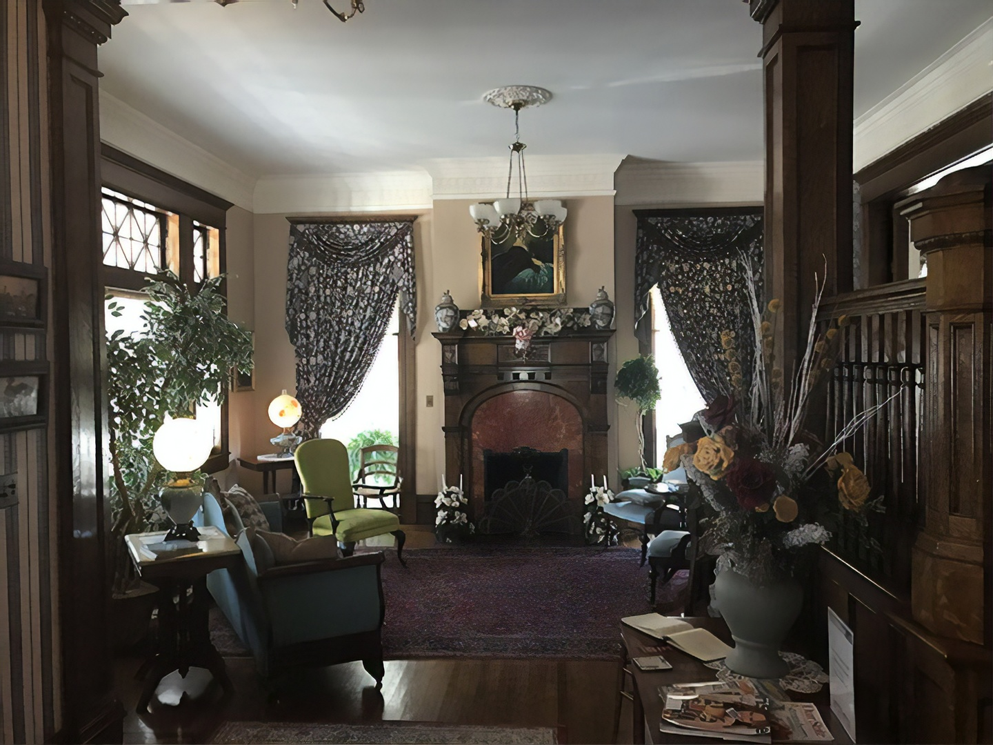 A living room filled with furniture and a large window at Rosehill Inn Bed & Breakfast.