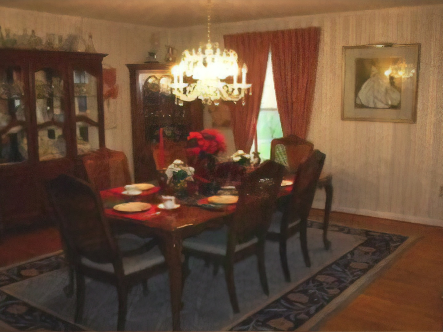 A living room filled with furniture and a fire place and a dining table at Middle Grove Inn.
