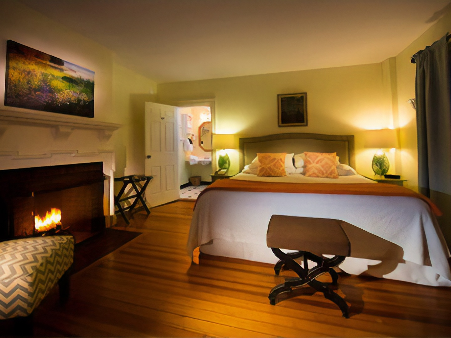 A bedroom with a view of a living room at York Harbor Inn.