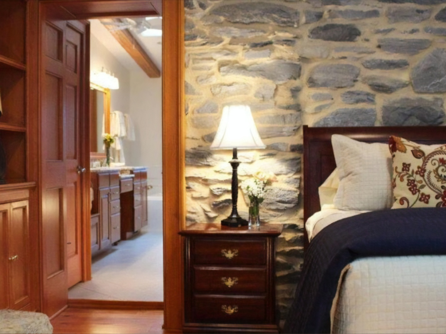 A bedroom with a view of a living room at Hillbrook Inn.