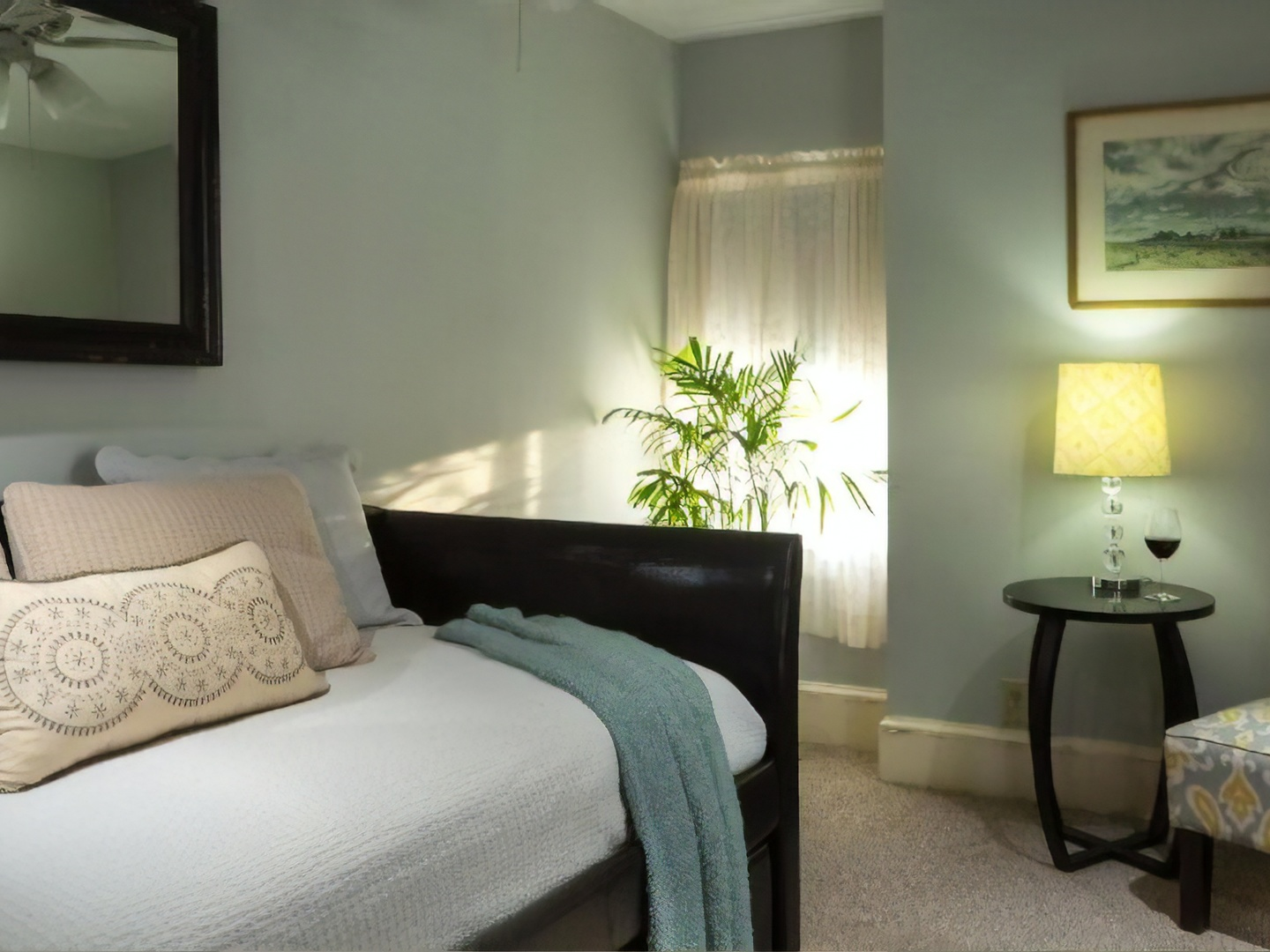 A bedroom with a bed and desk in a hotel room at Carroll Villa Hotel.