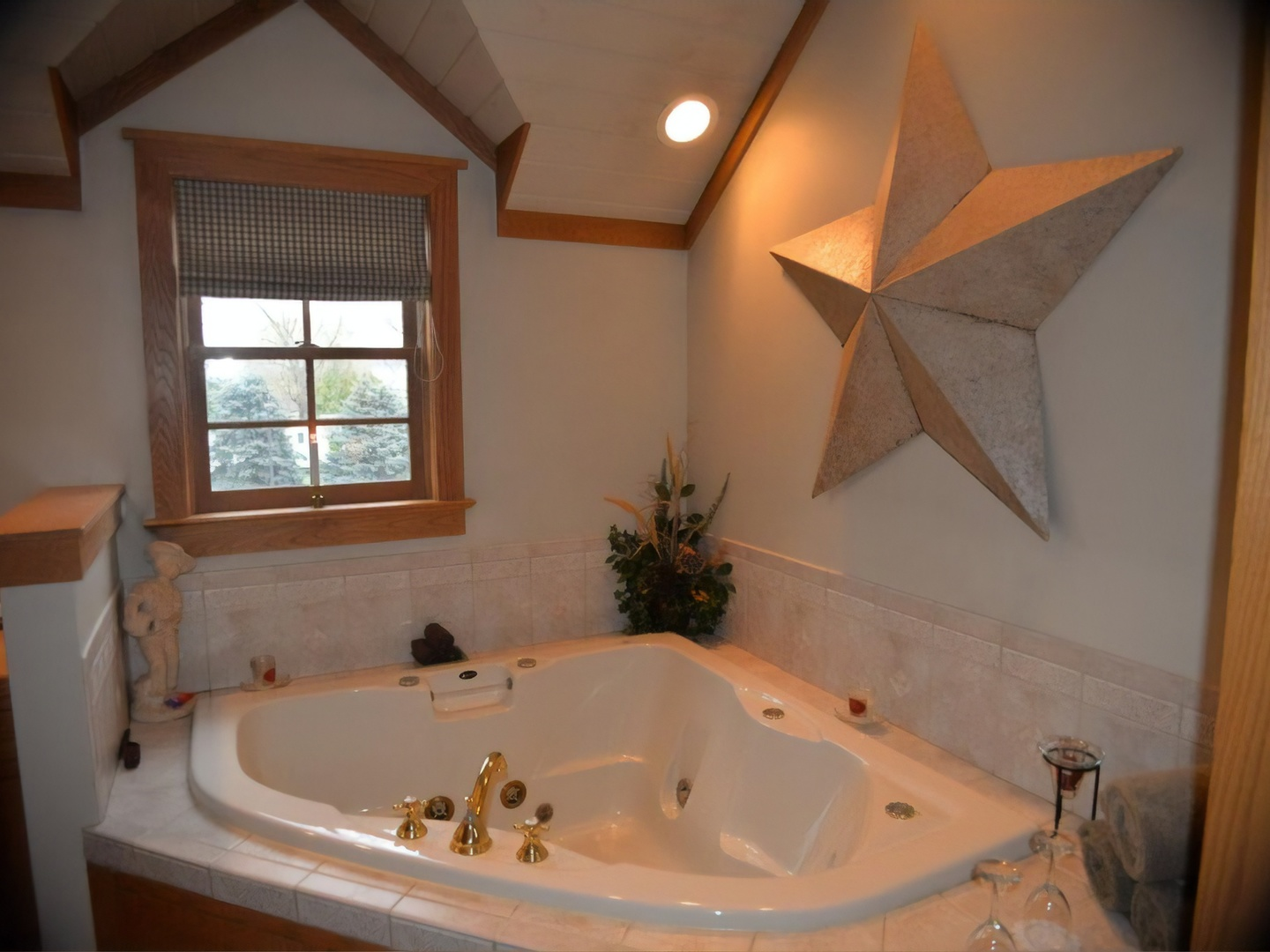 A large white tub sitting next to a sink at The Inn & Spa at Intercourse Village.