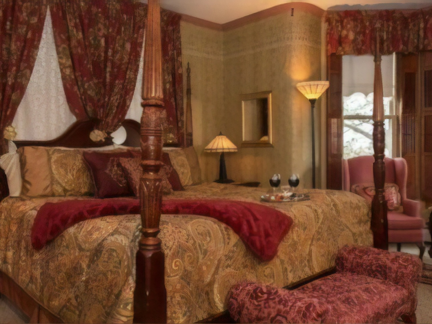 A bedroom with a large red chair in a room at Sutherland House Victorian B & B.