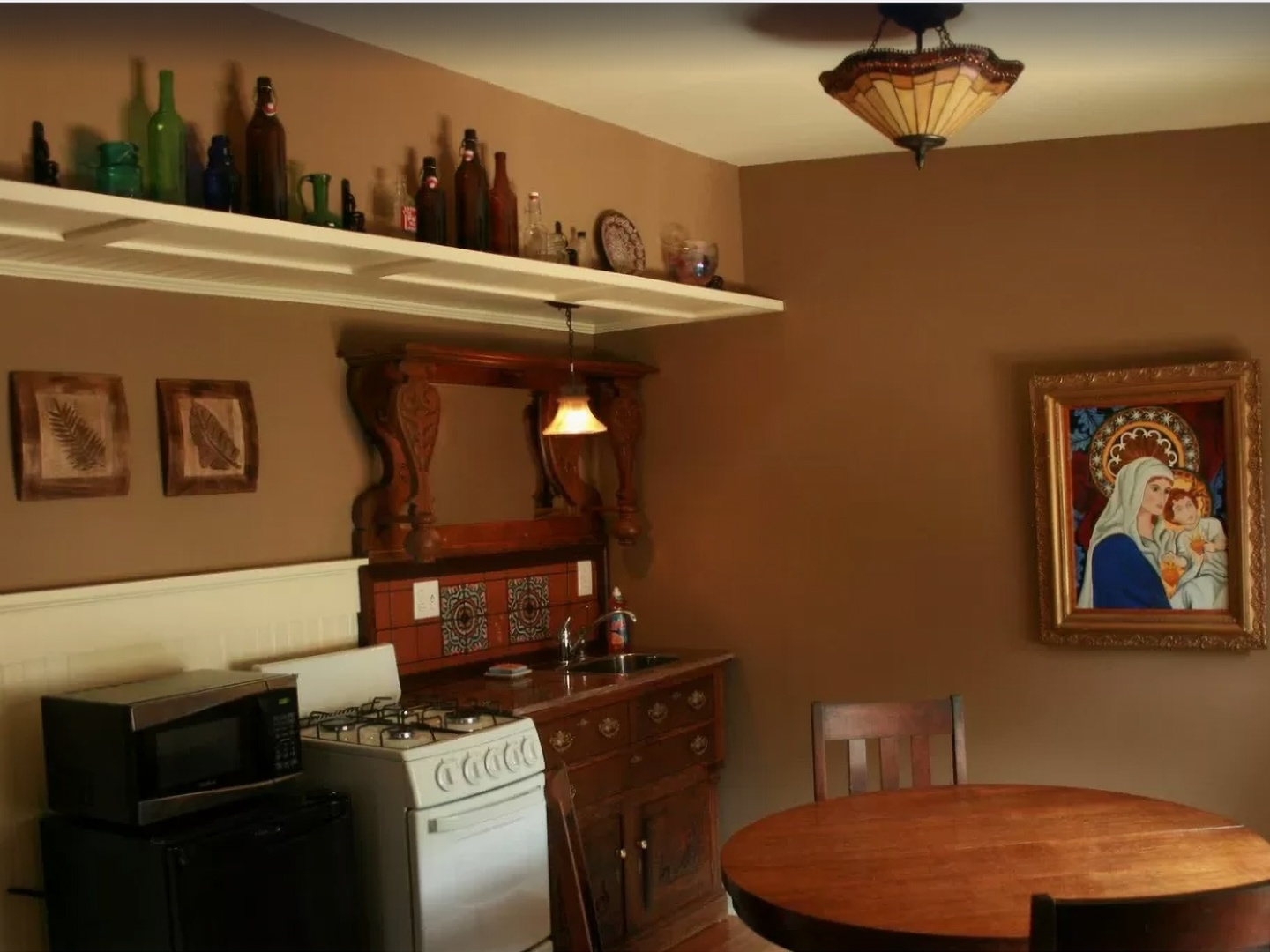 A kitchen with a table in a room at The Sea Gypsy.
