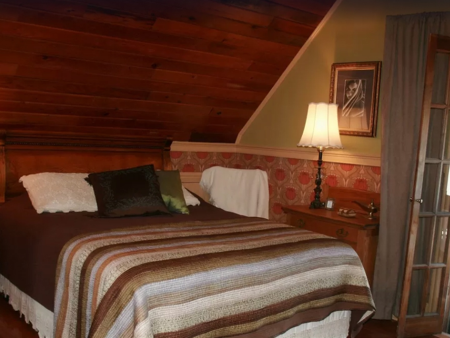 A bedroom with a large bed in a hotel room at The Sea Gypsy.