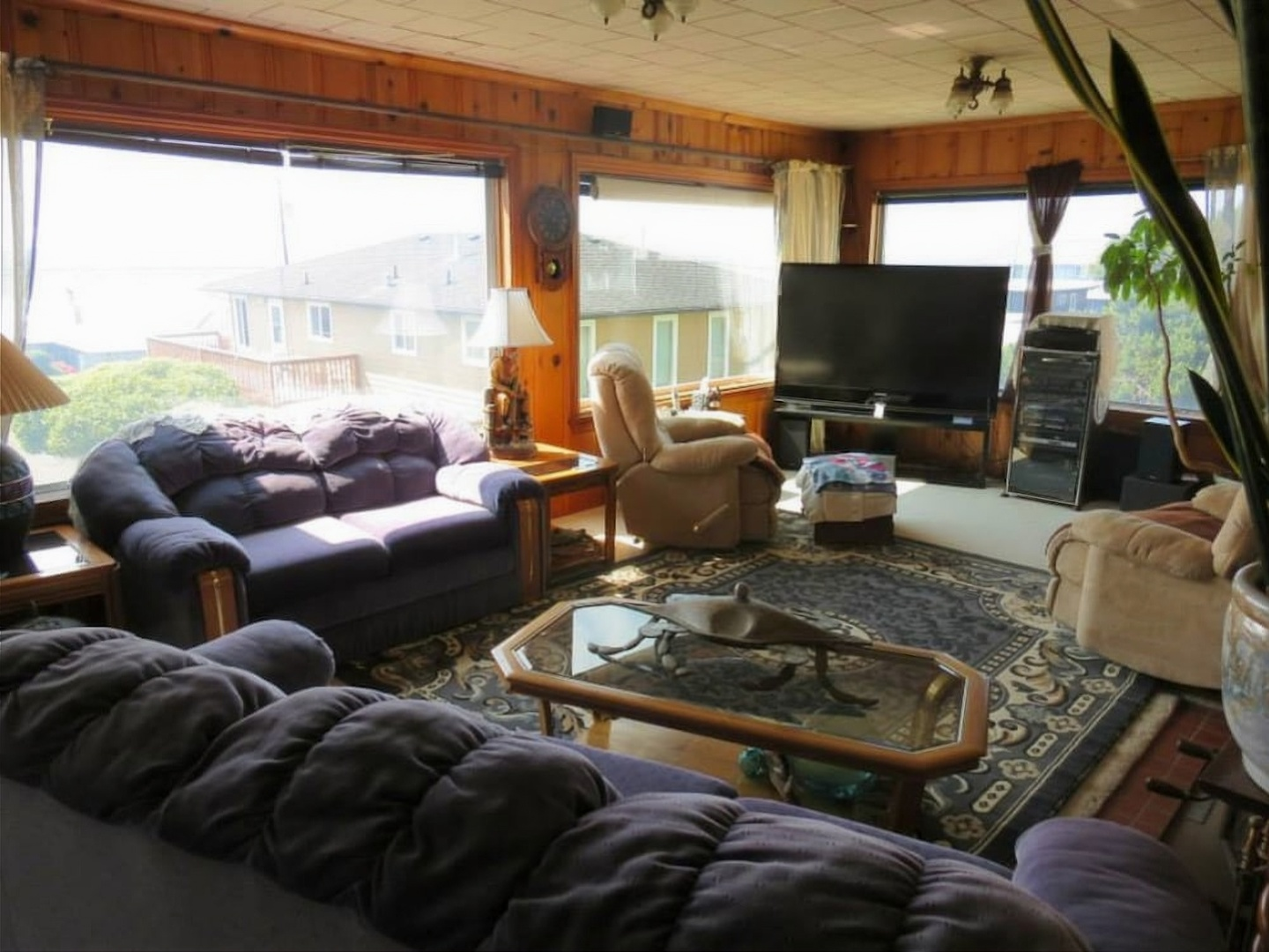 A living room filled with furniture and a large window at Brey House Ocean View Bed and Breakfast.