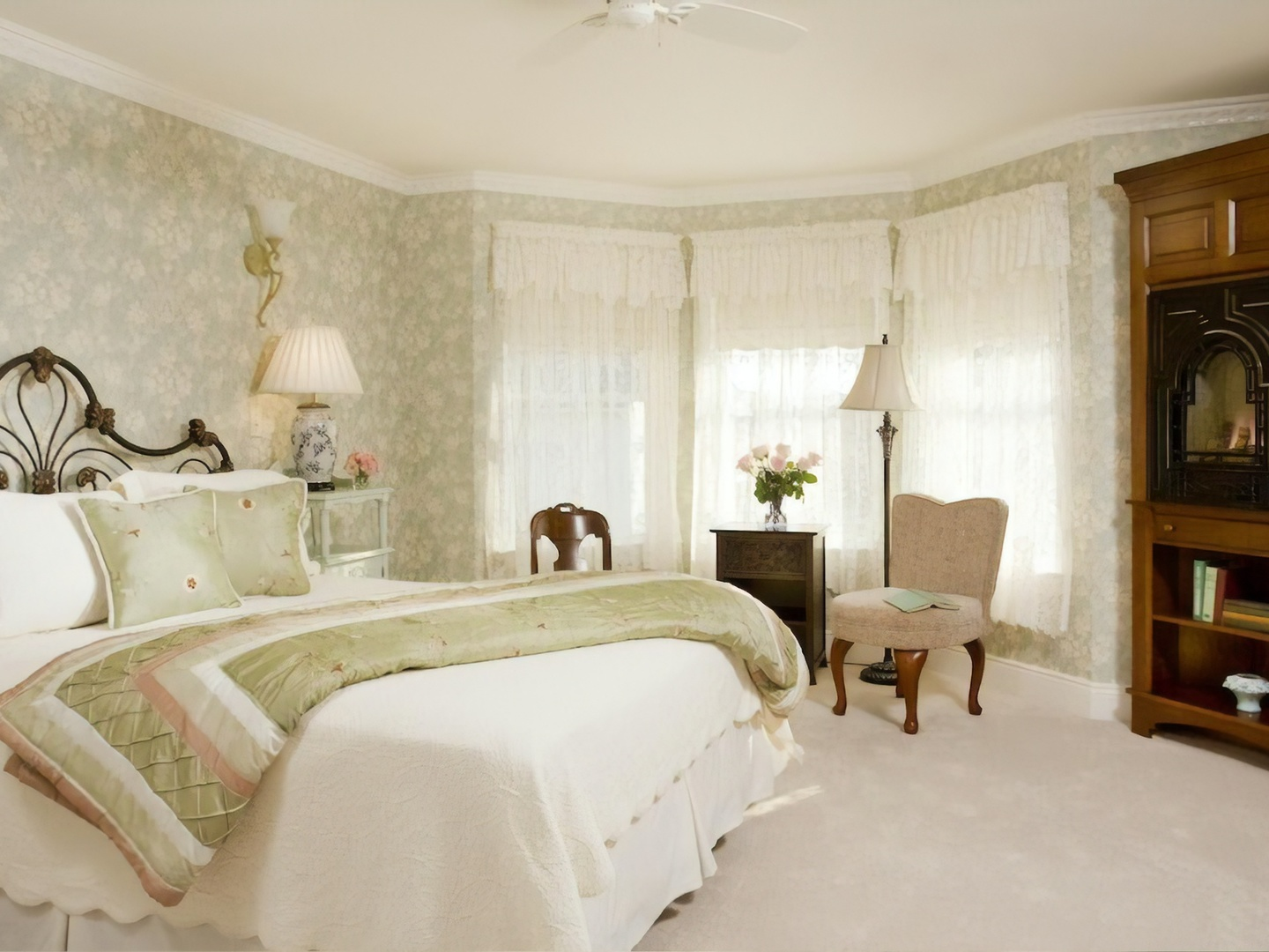 A bedroom with a large bed in a room at Wilbraham Mansion.