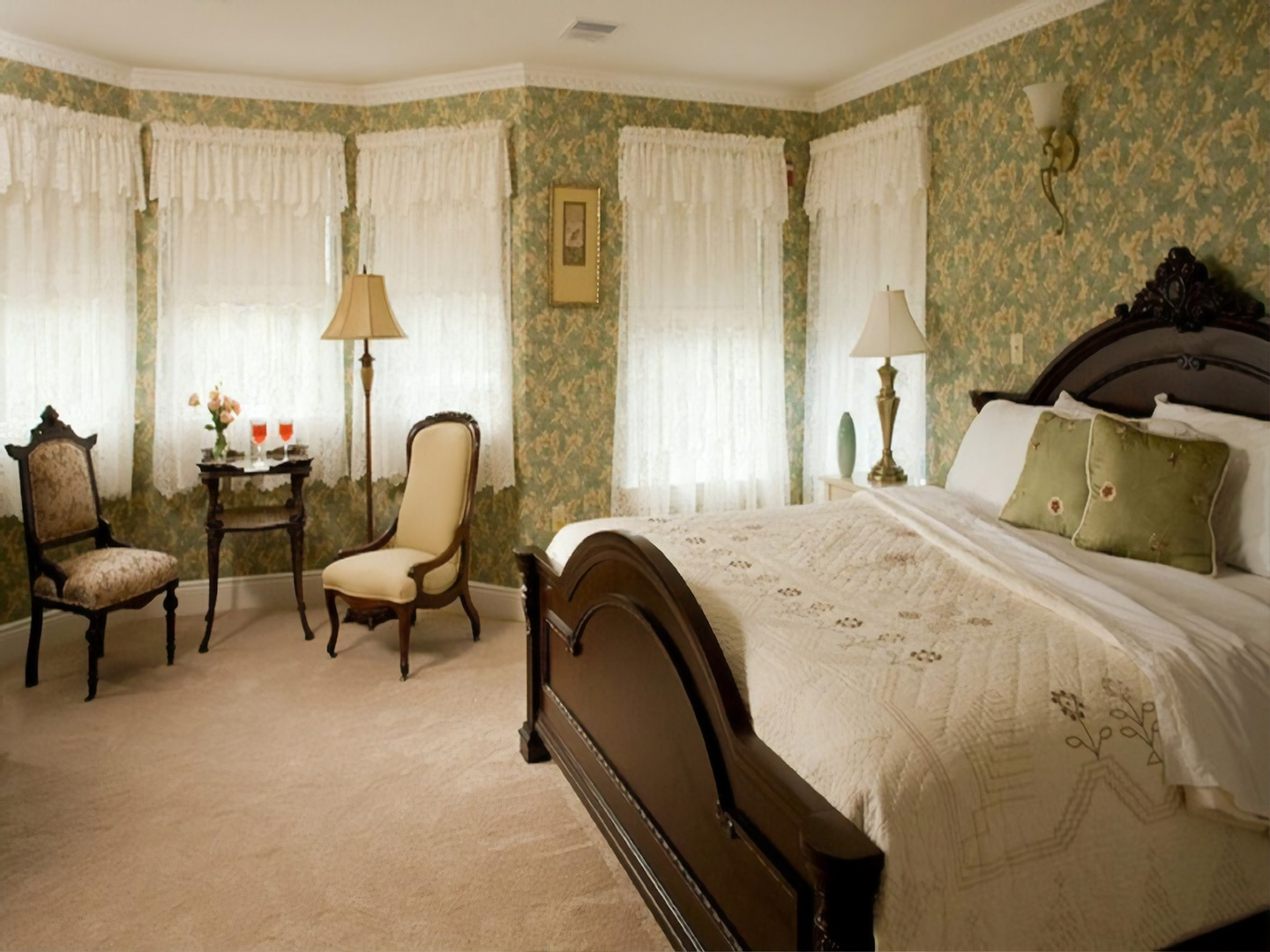 A bedroom with a large bed in a hotel room at Wilbraham Mansion.