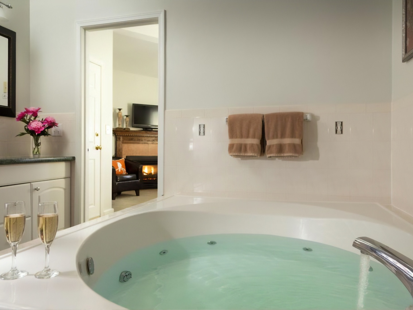 A large white tub sitting next to a sink at Beech Tree Inn & Cottage.