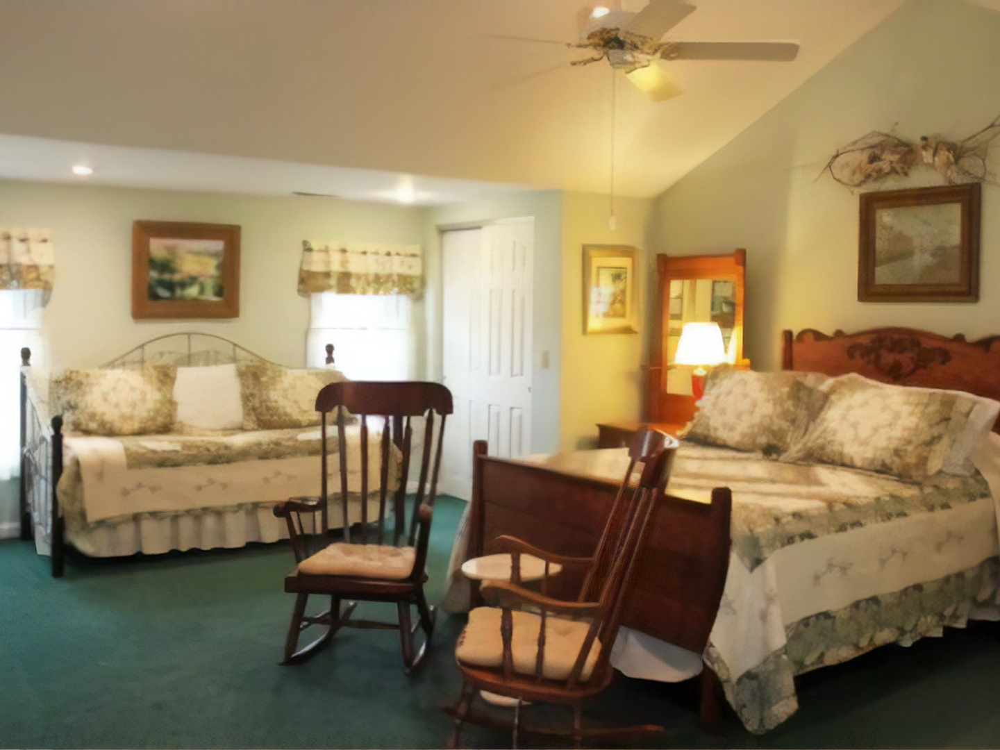 A bedroom with a bed and a chair in a room at First Farm Inn.