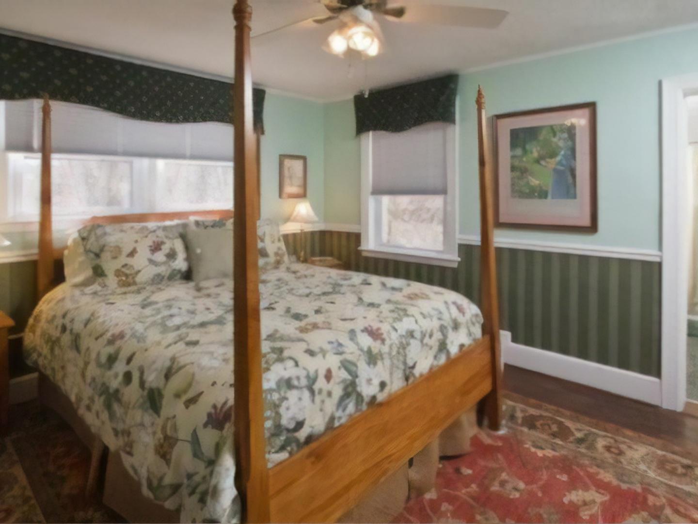 A bedroom with a bed in a room at A B&B at Llewellyn Lodge.